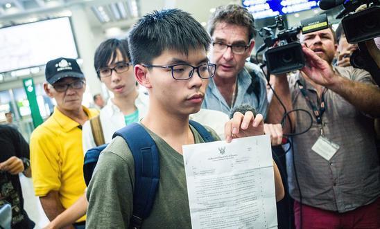 Hong Kong umbrella activist Joshua Wong walks free